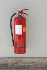 Fire extinguisher protection device at wall