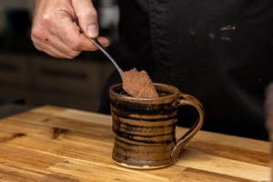 putting cocoa in the cup