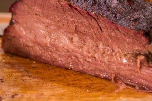 Smoked brisket sliced through the deckle