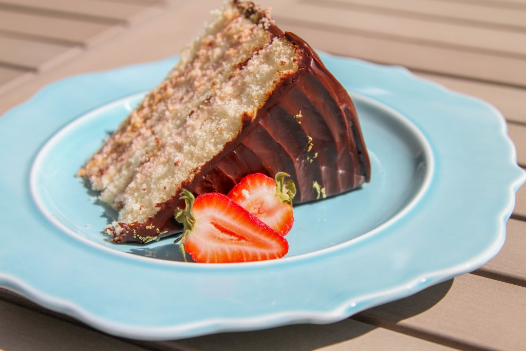 Slice of chocolate covered strawberry cake