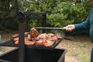 Santa Maria Style BBQ with open flame oak wood pork chops