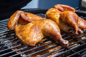 Grilling or barbecuing chicken