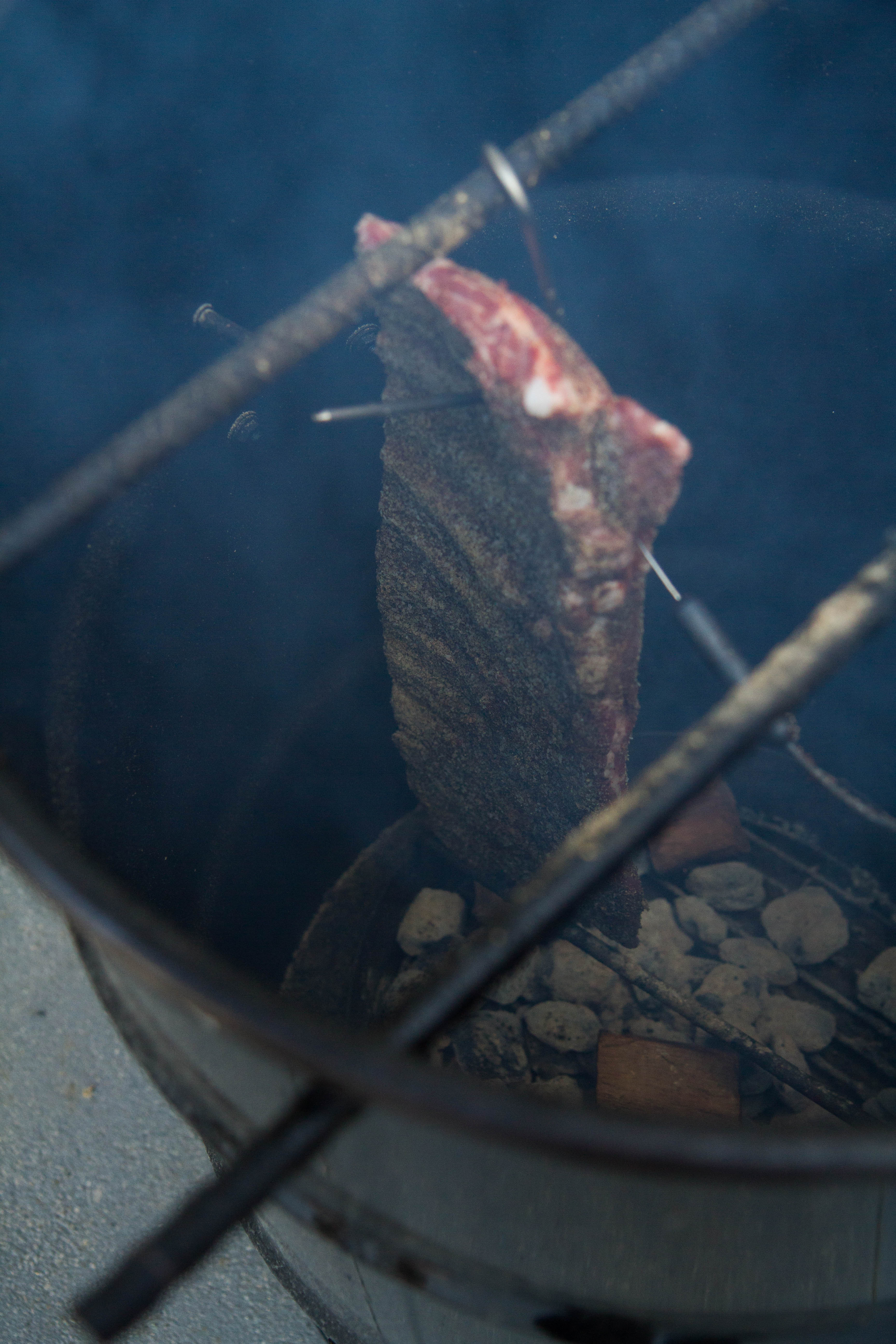 Ribs in a BBQ cooker
