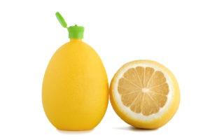 Lemon bottle on a white background