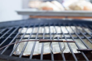 A grate clip should be used to monitor air temperature of grill or oven.