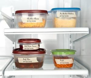 Storing Thanksgiving leftovers safely by labeling.