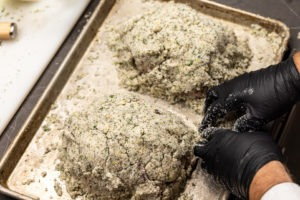 Cornish hens encrusted in a tomb of salt