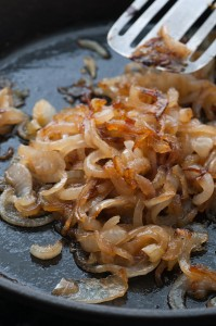 Precook filling ingredients like caramelized onions when making stuffed burgers