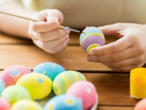 Coloring hard boiled eggs for Easter.