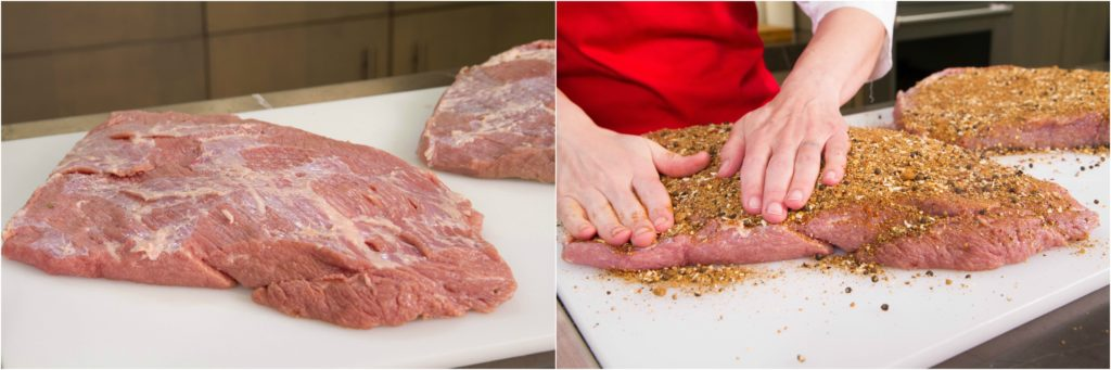 Applying spice rub to cured, rinsed brisket for pastrami.