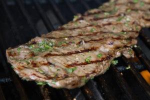 Skirt steak on a grill.