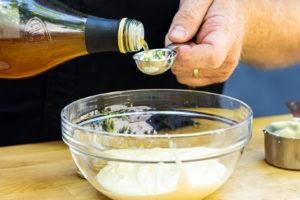 adding vinegar to the Alabama white sauce