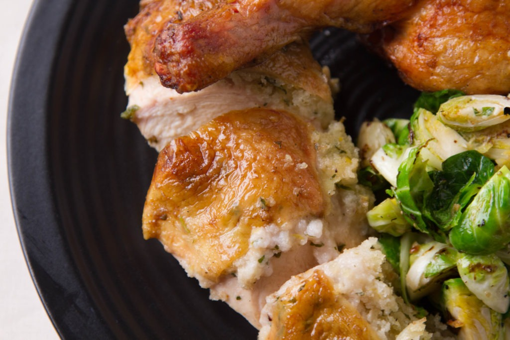Roast chicken on the smoker with brussels sprouts