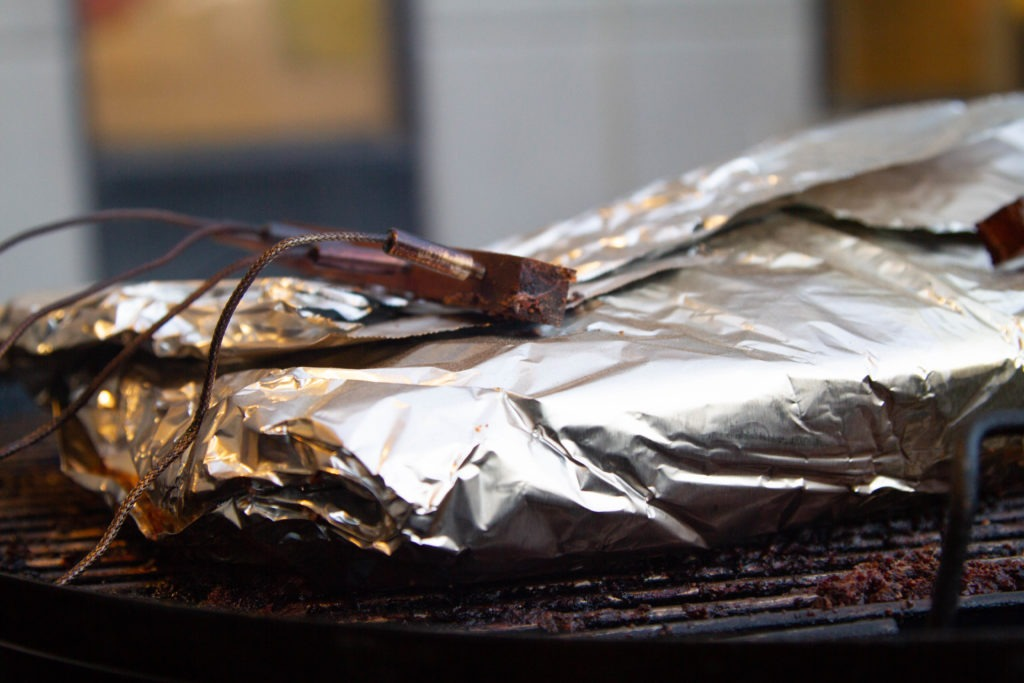 Smoked brisket wrapped in foil