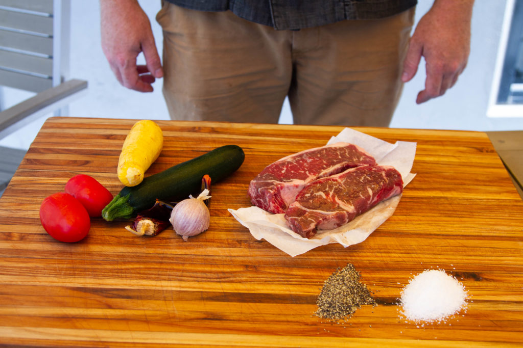 Ingredients for grilled strip steak with veggies