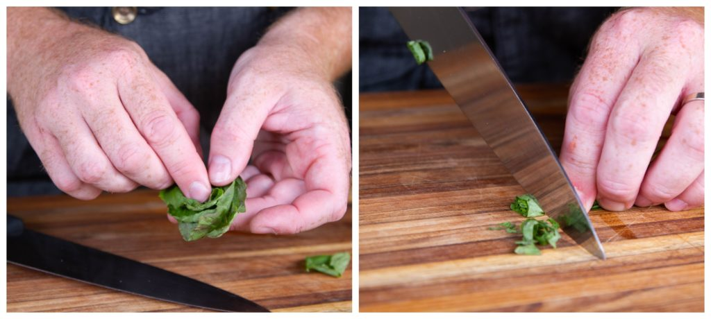 Chiffonade the basil by rolling it up and slicing it