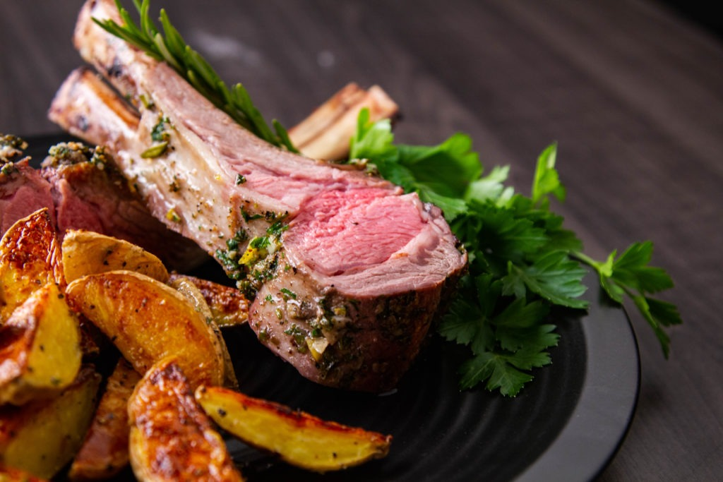 Serve the crown roast of lamb by slicing into chops.