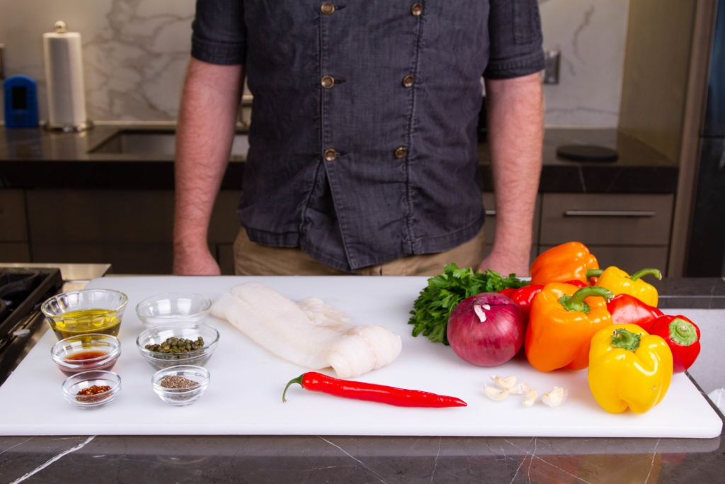 Ingredients for slow baked cod recipe with roasted peppers and capers