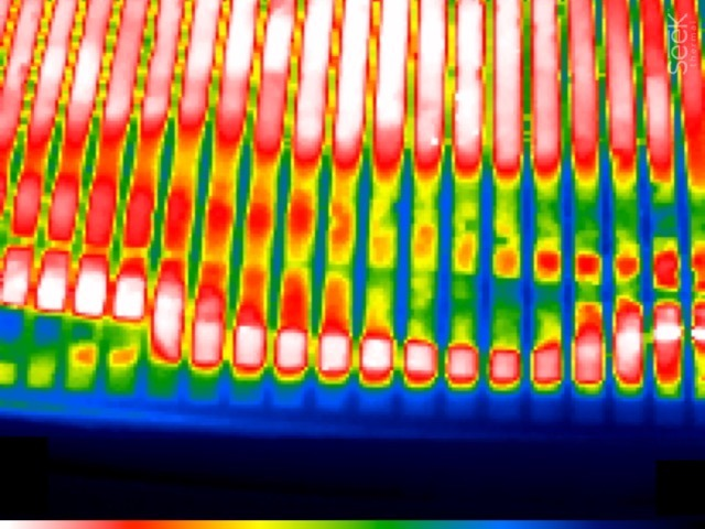 Thermal image of pellet smoker shows that there is a hot zone right at the front where the comes up around the drip plate. This is a probe-cable danger zone!