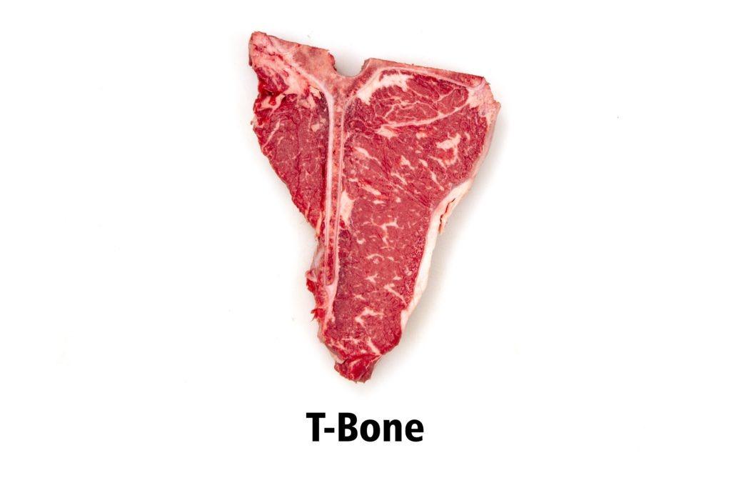 A T-bone steak, comprised of a strip, a filet, and a bone.