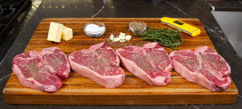 Porterhouse steaks should be simply seasoned with salt and pepper