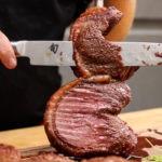 Slicing picanha steak