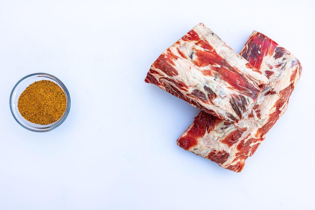 Raw beef ribs and bbq rub