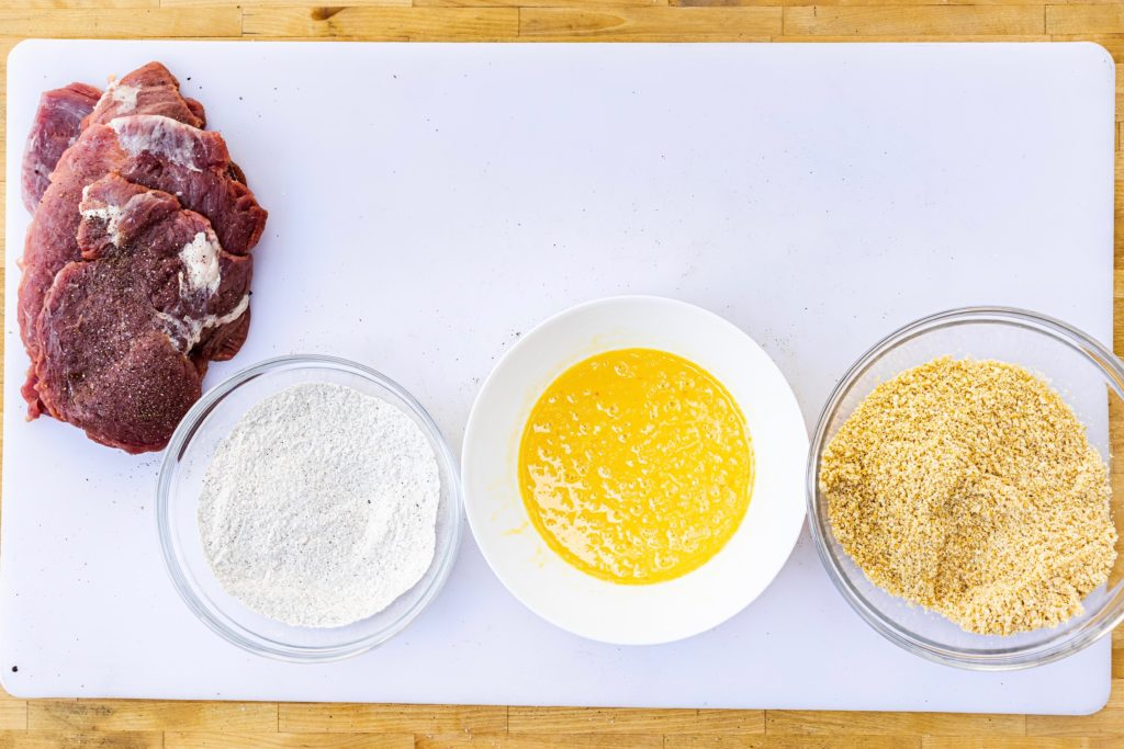 Prepare the breading station with flour, egg, and crumbs