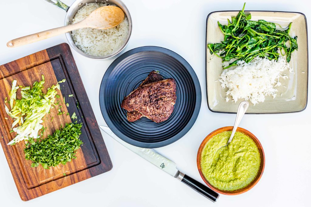 Delicious seared tuna steaks, served with rice and mole verde