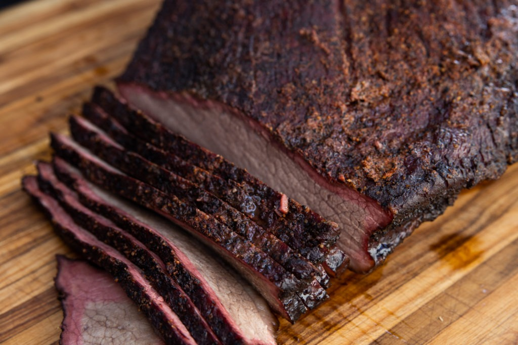 Sliced brisket showing bark and smoke ring.