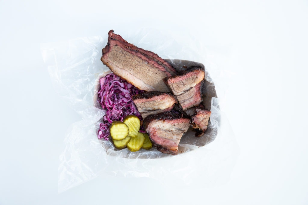 Sliced brisket with cabbage slaw and pickles
