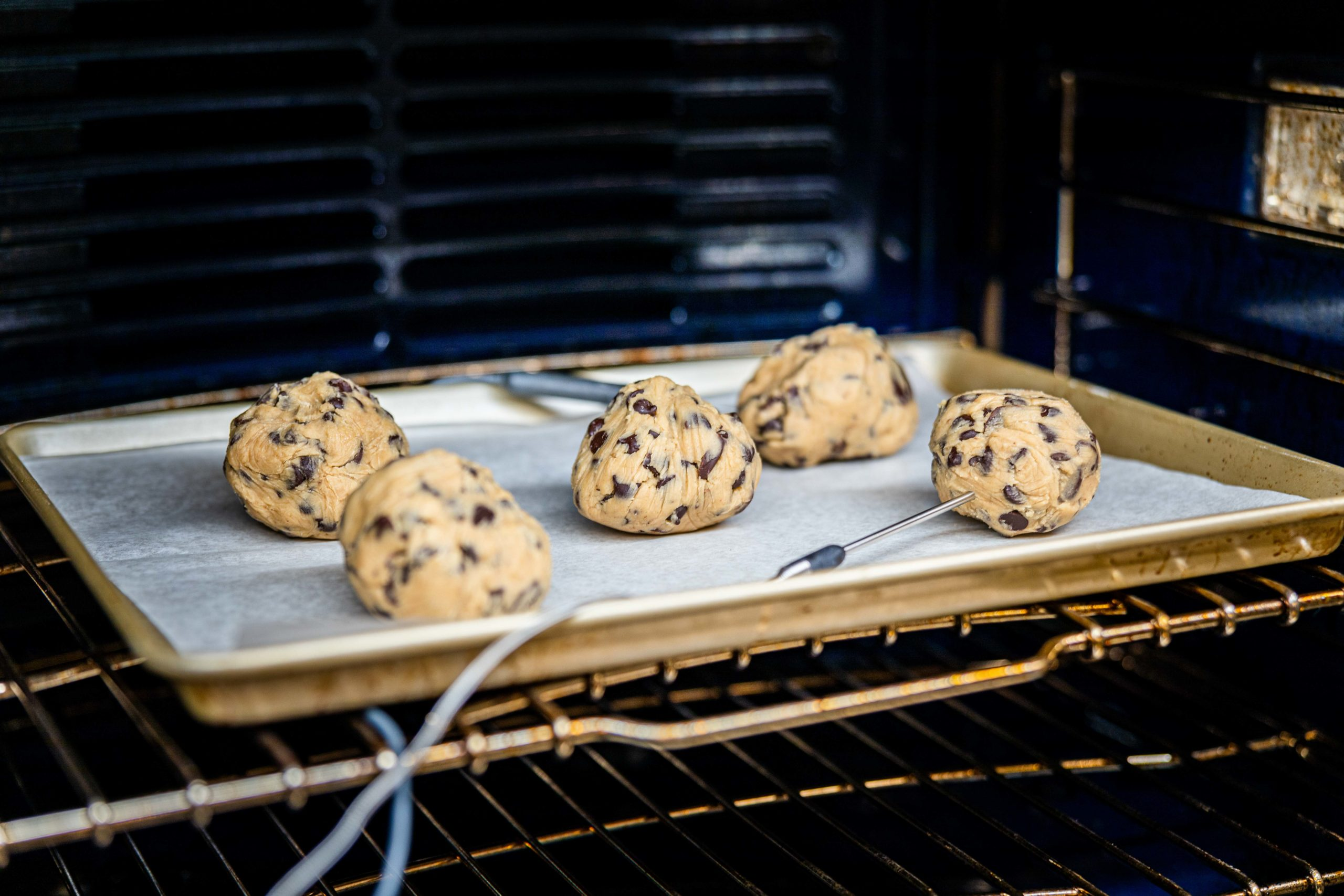 The cookies in the oven, probed with a thermometer probe