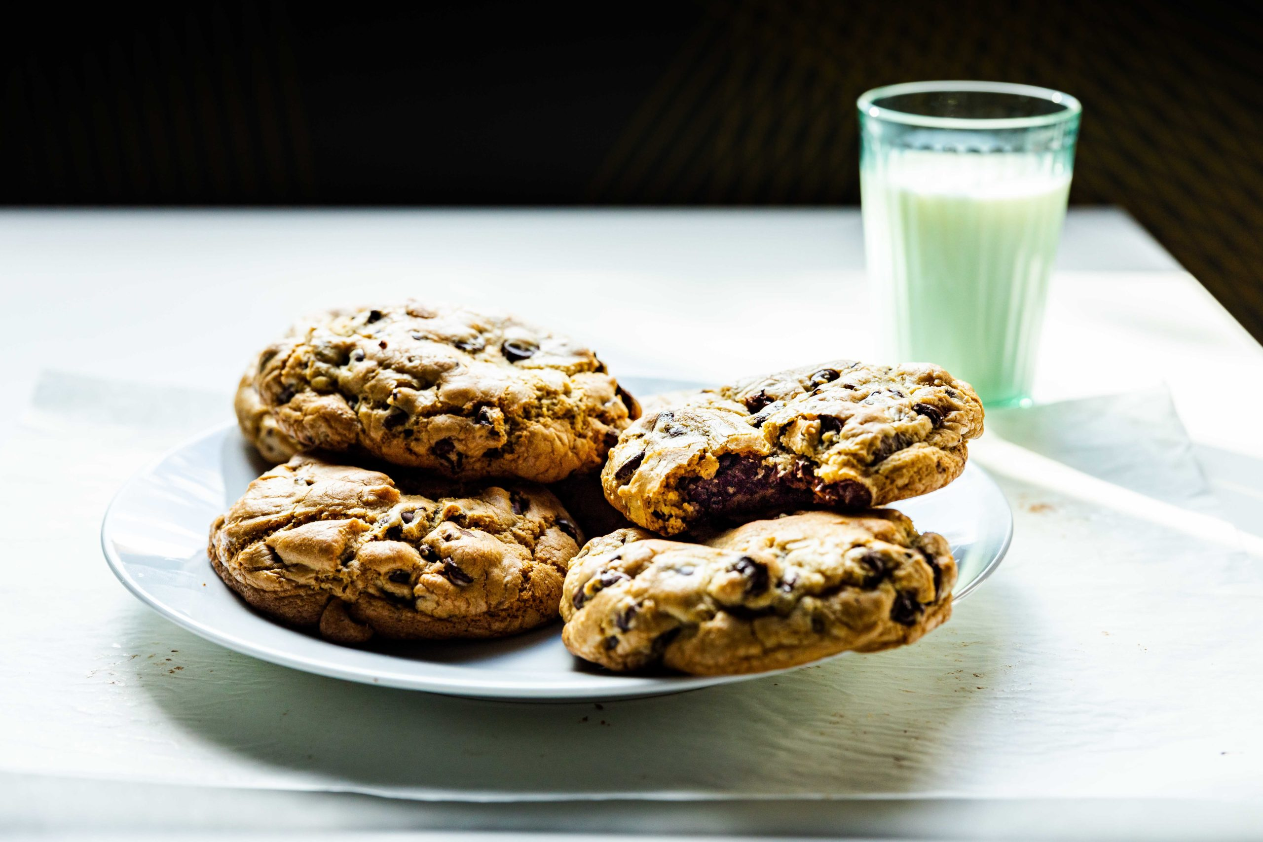 Warm chocolate chip cookies with milk