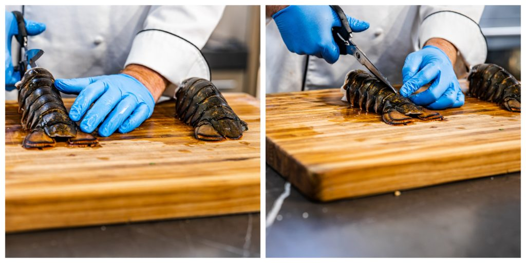 Splitting the top of the lobster shell.