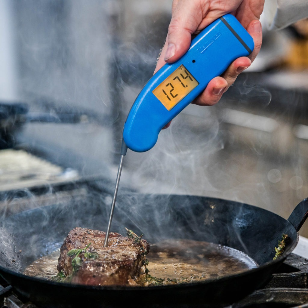 Perfectly temped steak—127°F, ready to pull from heat.