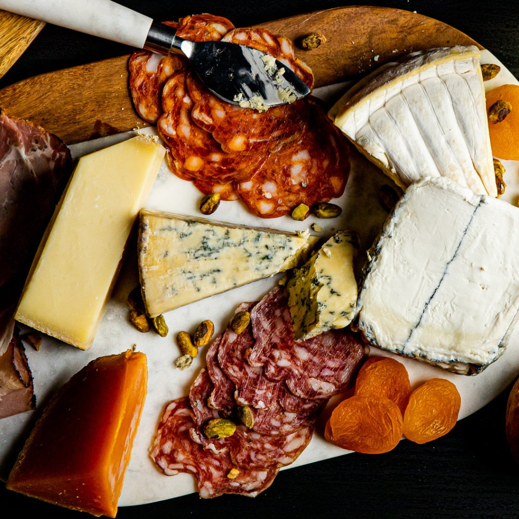 A cheese board at room temperature