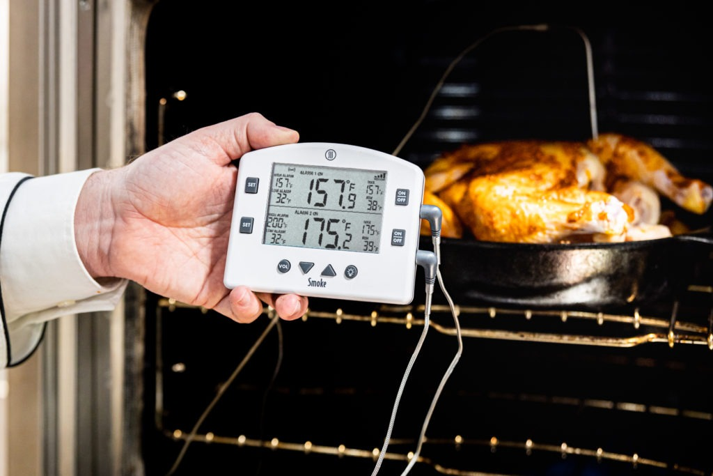 Set the alarms on the thermometer and cook the chicken.