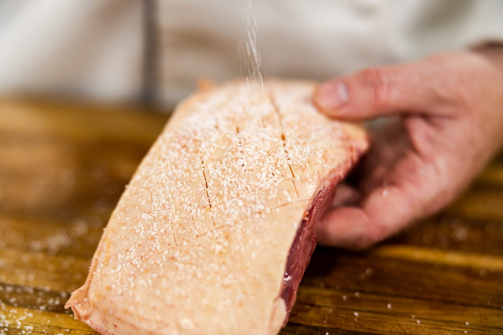 Salting a scored duck breast