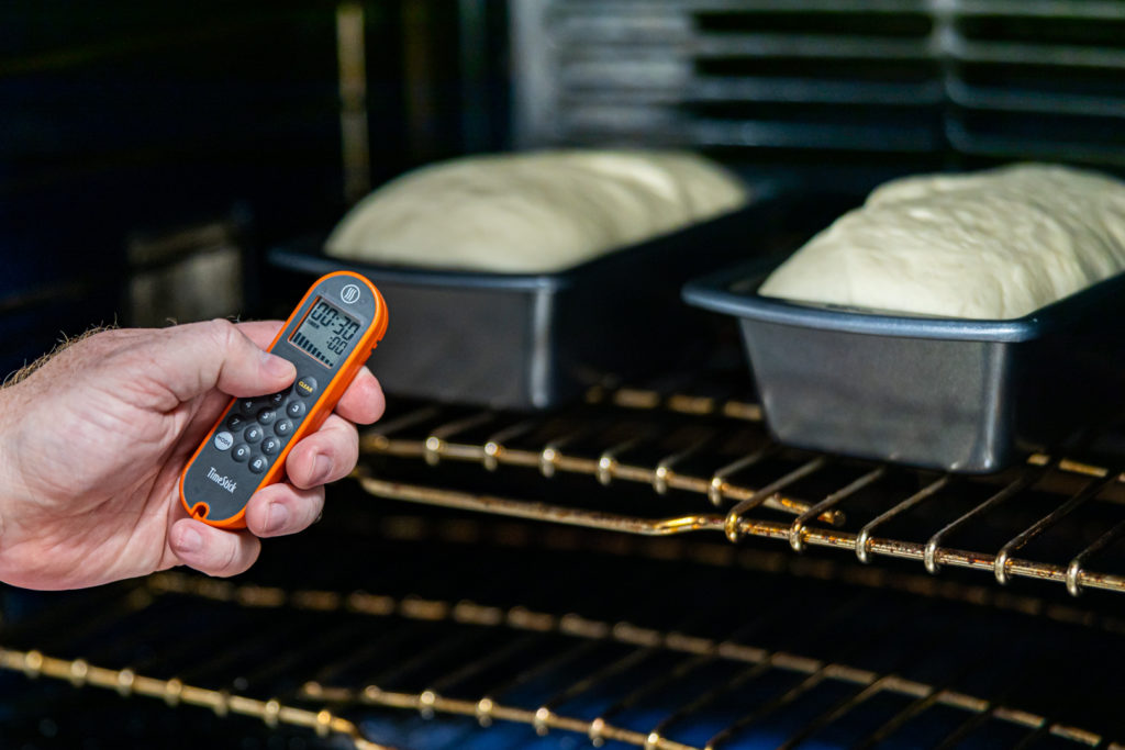 setting a timer for to cook the bread (bread in the oven)