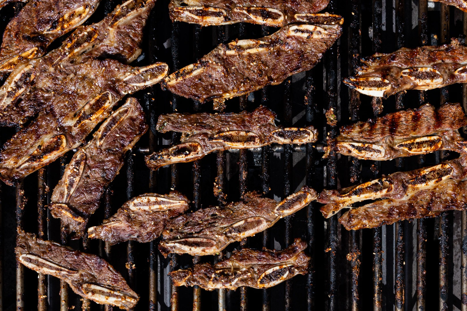 Deliciously browned, charry Korean short ribs on the grill
