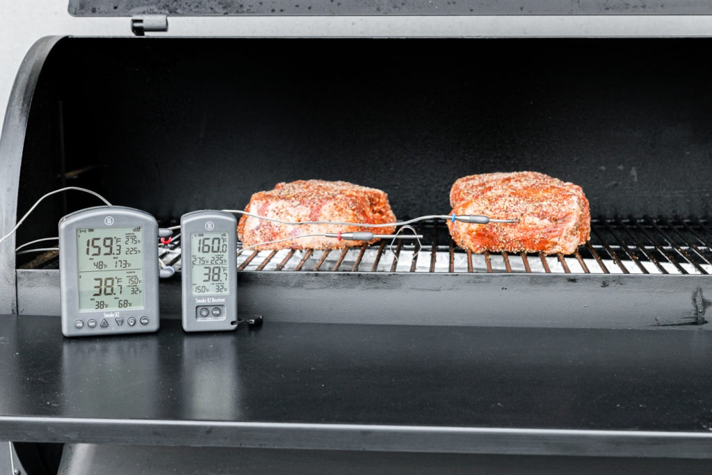 Chuck roasts in the smoker with a high-temp alarm set for 150°F