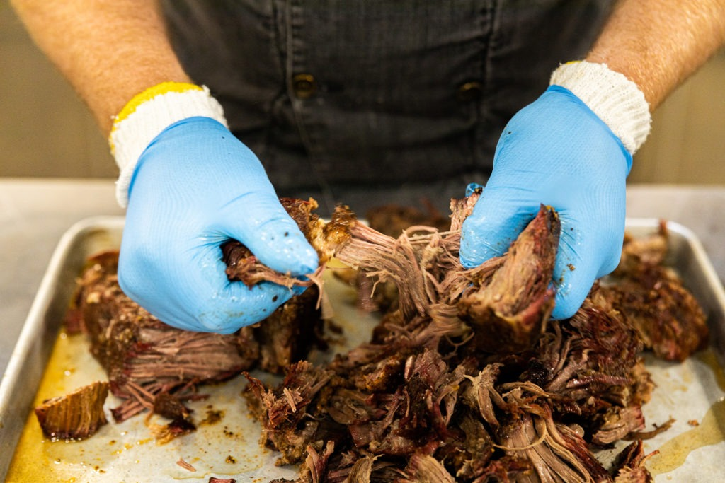 shredding the pulled beef