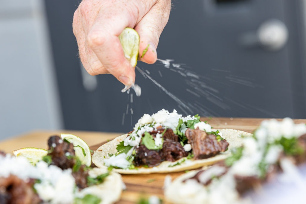Squeezing lime on a barbacoa taco