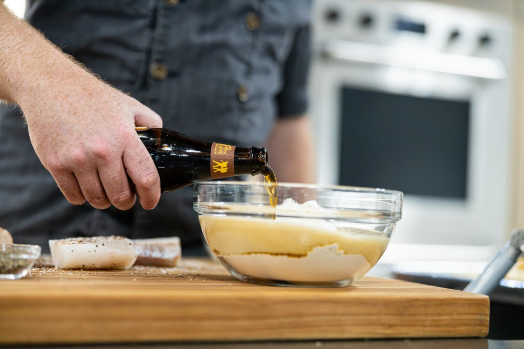 Adding beer to flour for fish batter