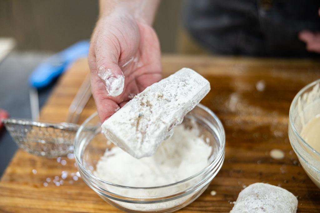 Dredging fish in flour