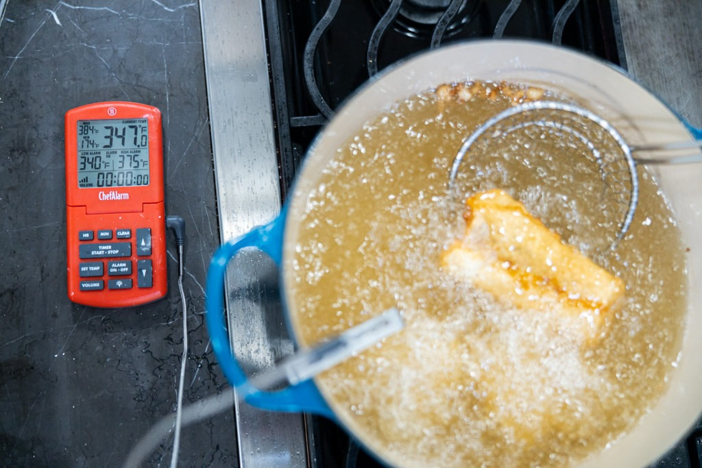 Fish frying in 347°F oil, with 375°F on the alarm thermometer.