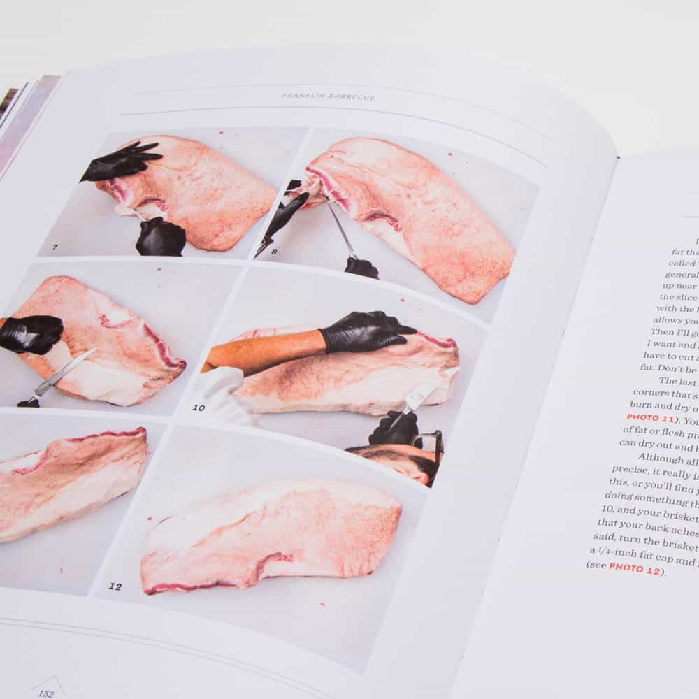 Picture of the interior of the book open to the page demonstrating brisket trimming.