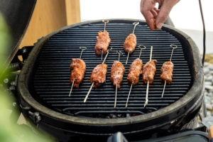 Seasoning the kebabs with extra seasoning