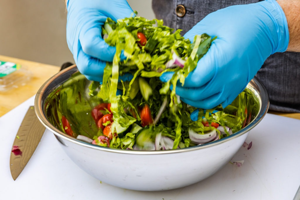 Making the salad for the shawarma