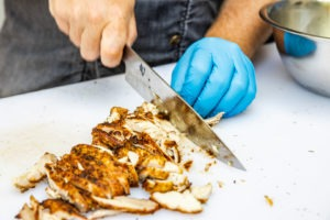 Slicing the grilled chicken